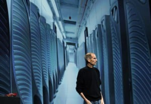 Steve Jobs is pictured with an image of server farm in Maiden
